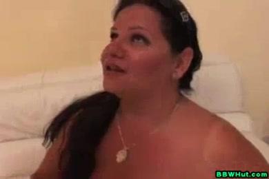 Huge tits milf gives handjob to bf.