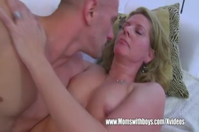 Hot blonde milf fucks a young stud in his car.