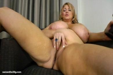 Nymphomaniac slut fucks her tight hole with dildo.