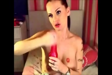 Busty british babe fucks with a dildo on webcam.