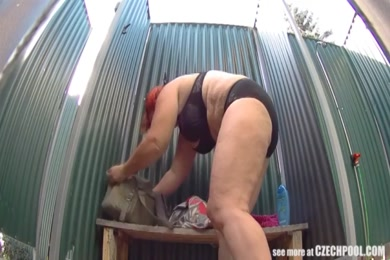 Naughty girl gives blowjob after the shower in public.