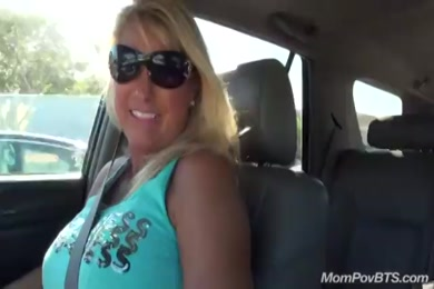 Hottie is a busty milf with sexy tits.